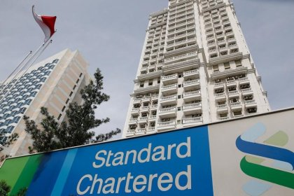StanChart to take $160 million charge from private equity sale