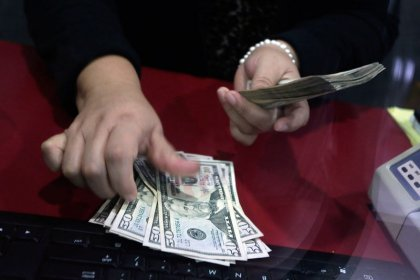 Dollar weakens as investors brace for expected Fed caution