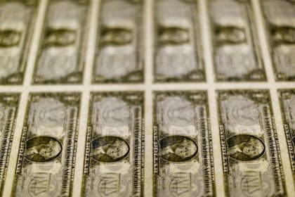 U.S. current account widens; companies bring home piles of cash