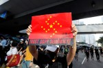 Hong Kong police fire tear gas, water cannon at petrol-bomb throwing protesters
