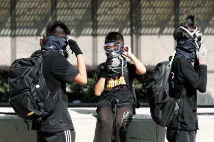 Hong Kong police fire tear gas, blue water jets at petrol-bomb throwing protesters