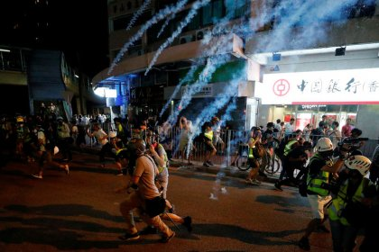 Hong Kong riot police move to curb airport protest after violent clashes