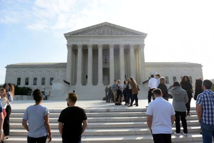 U.S. Supreme Court kicks off new term, with Justice Thomas absent
