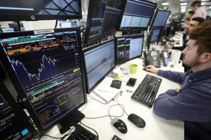 Pound and UK stocks surge on report EU, UK close to Brexit draft deal