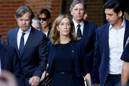 Actress Felicity Huffman reports to prison for part in U.S. college scandal