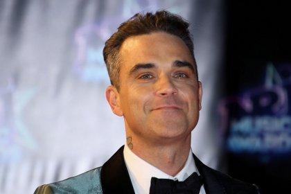Robbie Williams se inspira en Charles Dickens para su primer álbum navideño