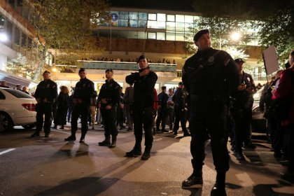 Serbia's opposition protest at state TV studios, forcing president to use side door