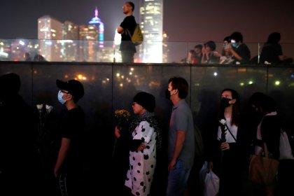 Veillée funèbre à Hong Kong après la mort d'un étudiant