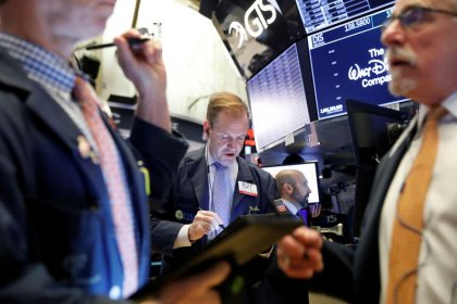 Trade hopes propel Wall Street to records; healthcare climbs