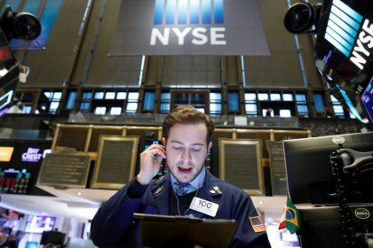 Wall St. eases from record levels at open after report dents trade optimism