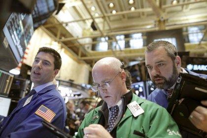 Global stocks edge higher on Trump remarks; dollar slides