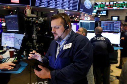 Stocks rally, dollar gains on robust U.S. jobs data