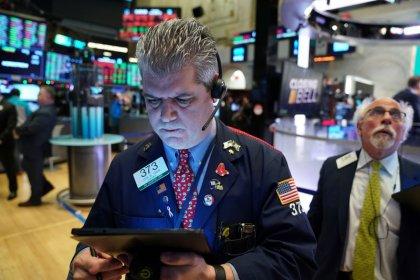 Stocks end 2019 near record highs, dollar slides