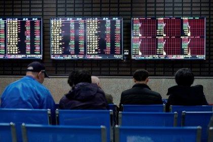 World stocks pause at record peak as markets assess U.S.-China deal