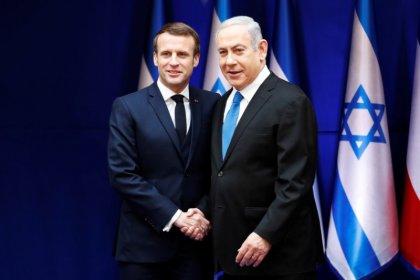 ماكرون: فرنسا لن تكون مرنة بشأن طموح إيران النووي