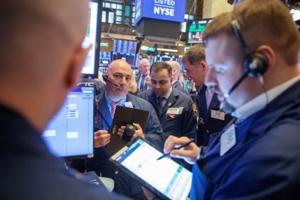 Global stocks edge up with positive chipmaker forecast, oil gains for the week