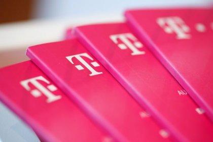 U.S. merger within reach, Deutsche Telekom CEO goes on offensive