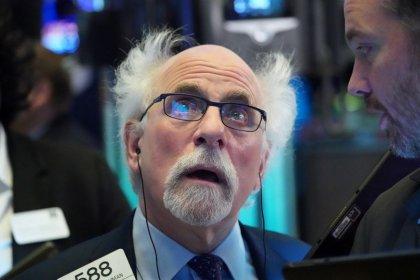 Wall Street clobbered as crude plummets, virus crisis deepens