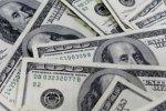 Dollar slows slide as investors seek shelter amid pandemic crisis