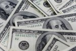 Dollar gains on Japanese demand before fiscal year end, pandemic weighs on mood