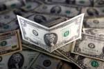 Dollar nurses losses amid caution ahead of Fed