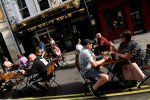 England to set tough new socialising rules after virus spike