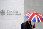 Upbeat earnings lift FTSE 100 as lockdowns, Brexit uncertainty weigh