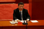 On war anniversary, Xi says China's interests won't be undermined