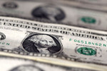 Dollar holds small gains as markets buffeted by COVID-19 woes, election uncertainty