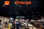 Orange beats forecasts in third quarter, raises interim dividend