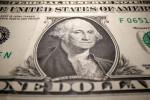 Доллар на пути к недельным потерям, проигрывает более рискованным активам