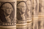 Dollar pinned down by lower U.S. yields, inflation data in focus
