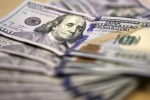 U.S. dollar fails to get usual safety bid from volatility in short term