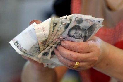 China January new yuan loans surge to record high, money supply increases