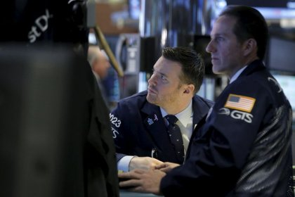 Wall Street closes lower as investors ready for earnings