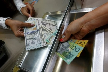 Australian dollar jumps on RBA view, sterling rises