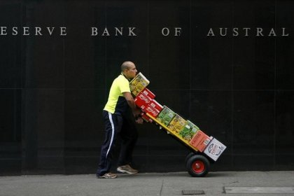 Australia cuts rates to historic lows to head off deflation
