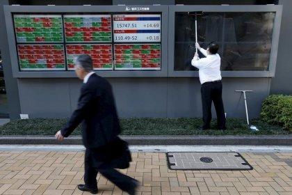 Global stocks, dollar subdued as Fed, BOJ meetings begin