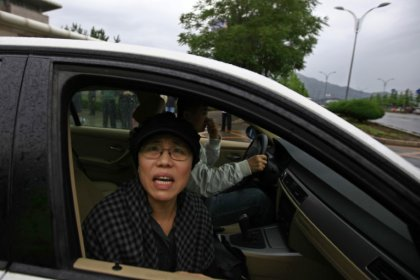 Chinese Nobel laureate's widow makes first appearance since funeral