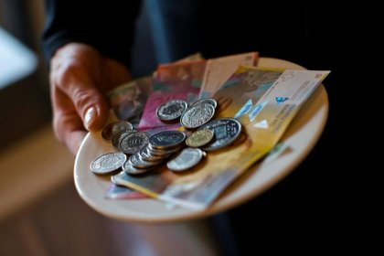 Swiss central bank ditches mantra on franc overvaluation