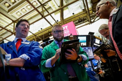 Wall St. edges up on telecom gains; Fed meet in focus