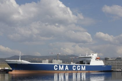 CMA CGM sees calmer waters for container shipping, looks landwards