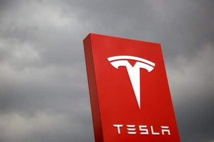 Tesla shares fall from record high after warning from analyst
