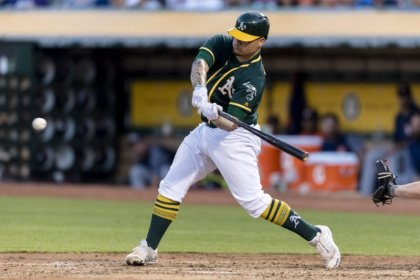 A's Maxwell first MLB player to kneel during anthem