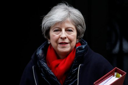 May launches review of high UK university fees, promising fairer deal