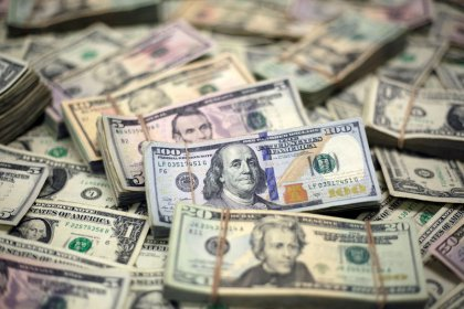 Dollar finds footing after steep fall, holds above three-year lows