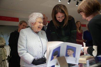 Queen Elizabeth makes surprise appearance at London fashion catwalk