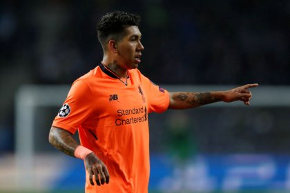 Liverpool's Firmino cleared by FA over Holgate clash