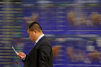 Asian stocks slip as U.S. rate risk sours sentiment, dollar holds gains