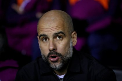 Guardiola charged by FA for yellow ribbon protest